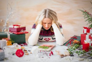 48971402 - woman depressed with christmas gift clutter